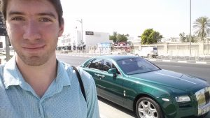 Standing next to a green Rolls Royce in Dubai