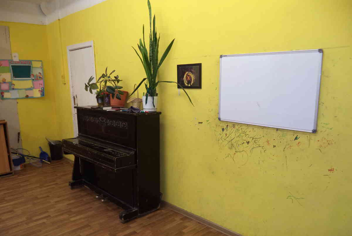 A piano in a Russian public school classroom