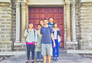 Picture of us standing in front of the stone church in Nha Trang