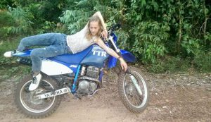 Joanna on a dirt bike in Cambodia