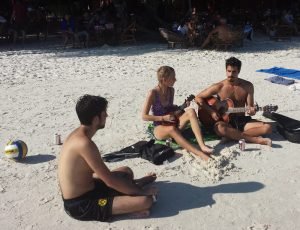 A picture of three people playing guitar on Koh Rong